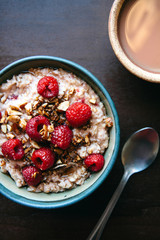 Oatmeal with raspberries and almonds and a cup of tea