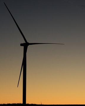 Wind turbine on an Iowa farm at sunset