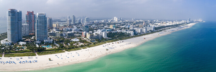 Miami South Beach Aerial Panorama Tourist Destination Sunny Day Hotels and Green Ocean Water