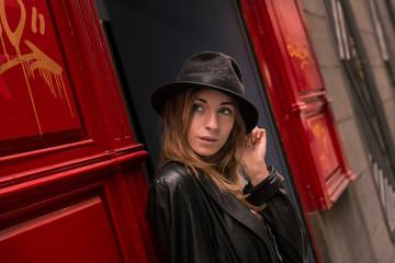 Trendy girl in black hat posing