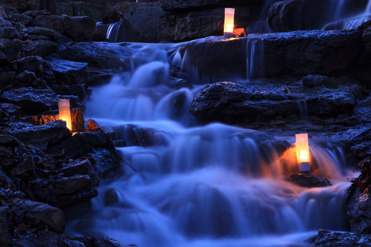 Cascading Waterfall Garden with Candles