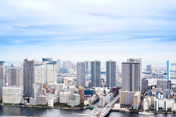 Asia Business concept for real estate - panoramic modern cityscape building bird eye aerial view of Odaiba bay and rainbow bridge under sunrise and morning blue bright sky in Tokyo, Japan.