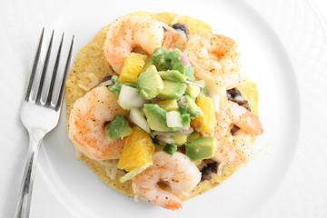 Shrimp taco with avocado, oranges, and beans
