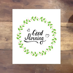 Good morning vector lettering card with laurel branch. Hand drawn illustration phrase on paper. Handwritten modern brush calligraphy for invitation and greeting card and posters