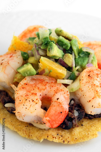 "Mexican shrimp tostada with re-fried beans and avocado salsa"" Stock ..."