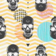 Kitschy seamless pattern with sugar skulls, multicolored circles of different textures, orange and white zigzag lines on background. Vector illustration in pop art style for fabric print, wallpaper.