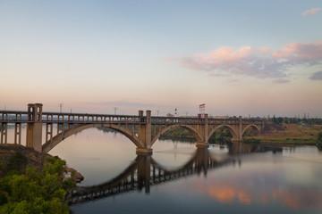 sunset on the Dnieper. Bridge in Zaporozhye, Ukraine