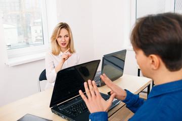 Office workers having a dispute
