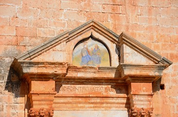 Religious painting above the entrance to the Agia Triada monastery, Crete.