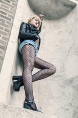 Alternative styled woman portrait on high position in street scene