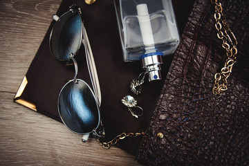 Top view of female fashion accessories. Perfume with sunglasses