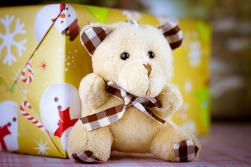 Teddy Bear and   gift wrapped present  on a nature background,Christmas,happy new year