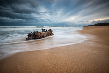 Stormy morning / Stormy sea beach with slow shutter and waves flowing out