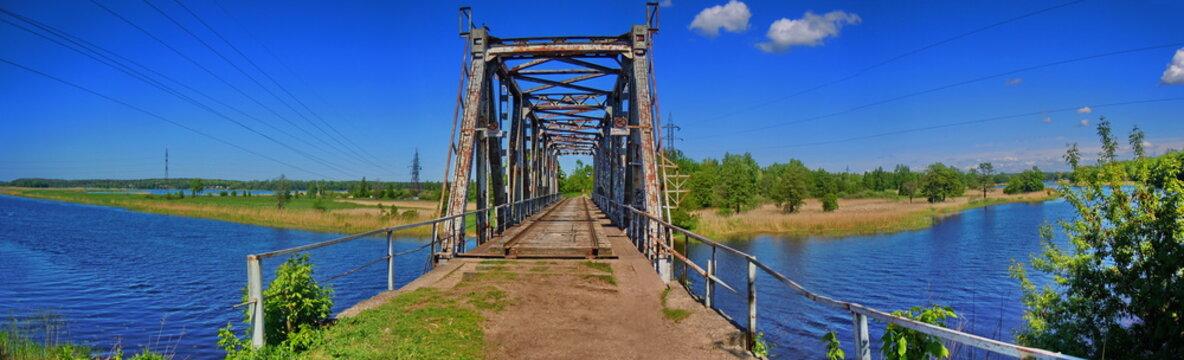 Panoramic view of abandoned railway bridge (Riga, Latvia)
