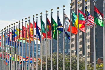 Spoed Fotobehang New York City Flags of all nations outside the UN in New York City.