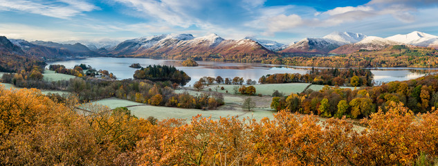 Beautiful view of Derwentwater in the English Lake District on a frosty Autumn morning with snow on the fells.