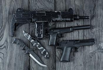 gun and two pistols,UZI submachine gun,firearms, terrorism