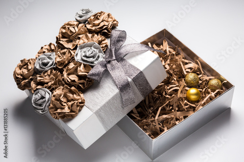 christmas gift box decoration on white background golden silver present box close up