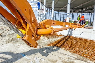 Detail of mechanical joint at crane's arm. Concrete transport ov