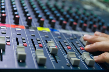 selective focus finger tuning of sound mixer close up
