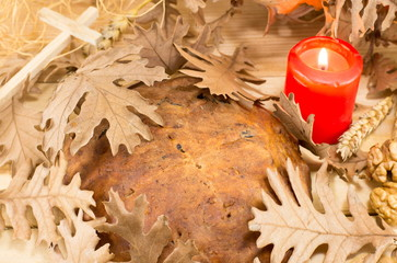 Orthodox Christmas bread covered with Yule log leaves