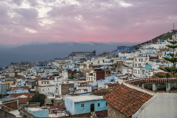 Africa, Morocco, Chefchaouen or Chaouen  is the chief town of the province of the same name. Range of the Rif Mountains in the Background.