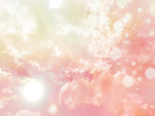 Beautiful pink pastel sky with sun and cloud with bokeh effect