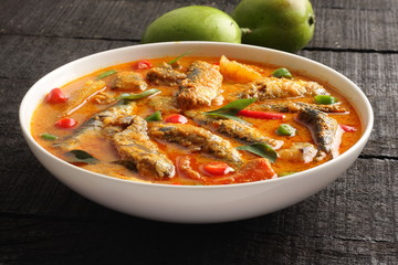 Delicious coconut milk fish curry,with mango cuts