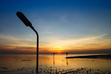 Silhouette of streetlight with beautiful sunset twilight sky at