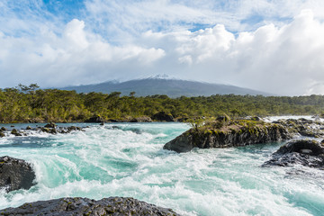 Petrohue Falls and Osorno Volcano with its snowy peak near Puerto Varas, Chile