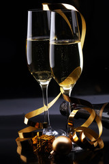 Conceptual Golden Brown Wine on Elegant Glass with Spiral Thin Wrapping Foils or Laces Decoration, on Abstract Brown Background - Champagne sylvester party