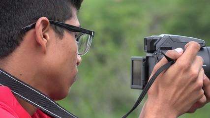 Teen Boy Using Digital Camera