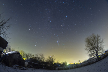 Night winter landscape in the countryside