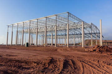 Construction Building Structure frame halfway for large factory warehouse .