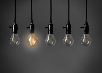 Light bulbs on gray background. Individuality concept