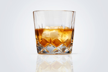Perfect glass of whiskey and ice isolated