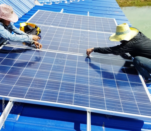 Solar Panel On Side Of Building : Quot electricians working to install solar panels on the side