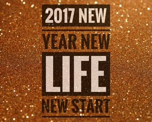 Happy new year 2017 words on shiny glitter background