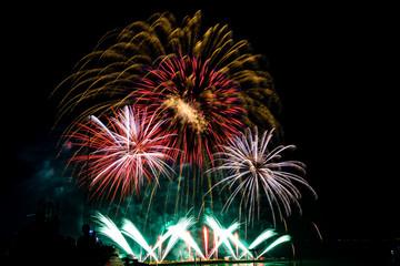 silhouette woman watching firework, beautiful colorful firework