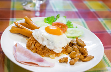 American breakfast style.American fried rice with egg and sausage, American breakfast style.