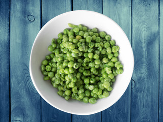 green peas in a white bowl