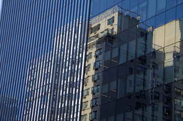 Midtown Manhattan NYC intersecting high-rise buildings architectural background reflections