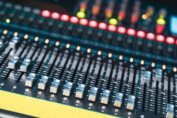 Hand adjusting audio mixer