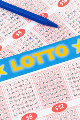 Lotto ticket gambling with pen, ticket is mock-up