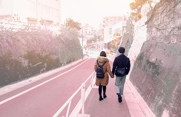 Couples in love holding hands walking on the pink road background