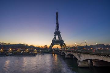 The Eiffel tower at sunrise in Paris