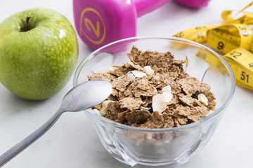 cereals, fruit and weights, concept of diet and living healthy