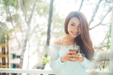 Portrait of a young asian woman drinking her morning tea. Fell r