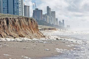Beach erosion after storm activity Wall mural