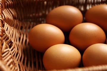Raw eggs in basket, closeup